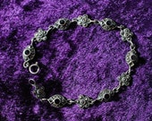 Vintage silver black onyx and marquisette flower and eye bracelet stamped 926 Thai