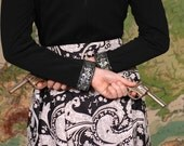 Vintage early 60's retro psychedelic black and white rocker dress with filigree neo tribal print silver collar and cuffs with matching belt