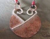 RESERVED......Abstract Heart pendant