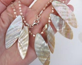 Shell Leaf Necklace with Blush-Colored Triangle Seed Beads Knotted on Silk Cord