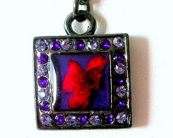 Purple and red necklace, gunmetal pendant floral