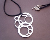 White Laser Cut Acrylic Interlocking Circle Sterling Silver and Rubber Necklace 2