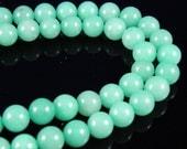 8mm Light Green Round Jade Beads, half strand