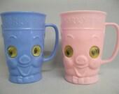 2 Vintage Porky Pig Plastic Mugs