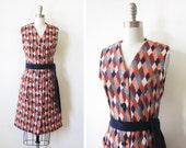 1970s mod dress / vintage 70s harlequin dress / orange and navy diamond button up dress