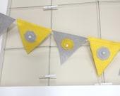 grey yellow felt flag banner