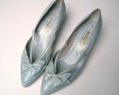 size 7.5 Vintage 1980s Powder Blue Leather Medium Heels. Bow fronts with Cut-out sides. Made in Spain