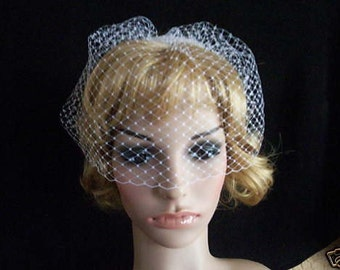 white or ivory  birdcage face blusher veil made with fine russian net. with comb ready to wear as soon as arrive
