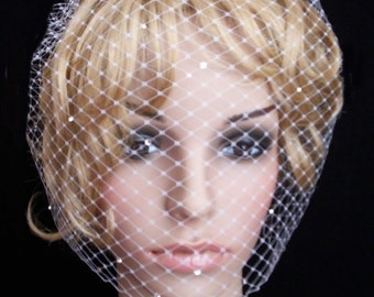 Full veil IVORY birdcage made with russian net .Comes with comb decorated with Swarovski crystals