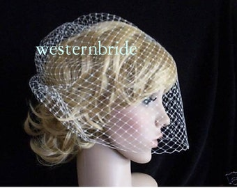 Full veil White birdcage made with russian net .Comes with comb decorated with Swarovski crystals