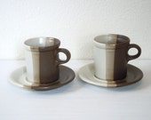 pair of vintage tricolor McCoy mugs with saucers