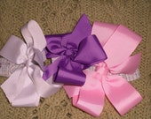 Large Hair bows three in a set each on a barrette clip