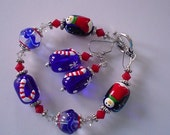 Blue and Red Penguin and Candy Cane Christmas Lampwork and Swarovski Beaded Bracelet and Earring Set