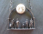 Promenade in the Moonlight, Sterling and Carved Moon Face
