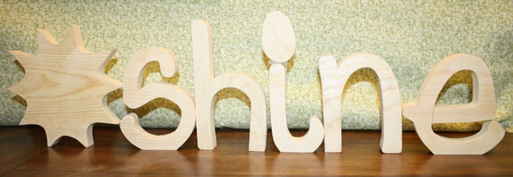 "UNFINISHED SUNSHINE wood letters with a sun for the ""SUN""."