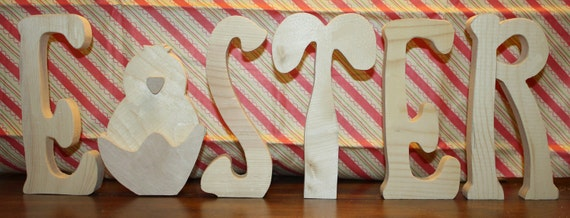 """UNFINISHED  Easter wood letters with chick as the """"A"""" and rabbit as the """"T""""."""
