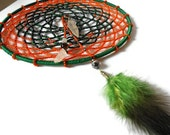 Dreamcatcher beaded in orange and dark green with bali silver leaf tumbled quartz and wire wrapped green feathers