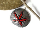 Painted sand dollar pendant silver,red and black