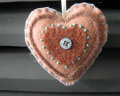 Felt heart shaped ornament perfect for country home decor or folk art style decorating