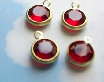10 ruby- red swarovski crystal drops, gold plated setting, 9mm