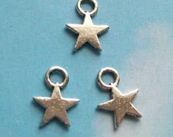 20 tiny solid star charms, silver tone, 12mm