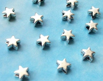 500 very tiny star beads, smooth/plain, shiny silver tone, 5mm