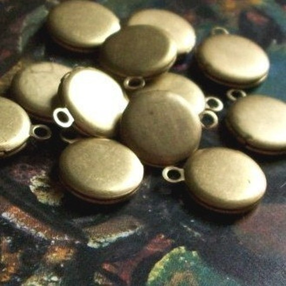 reserved for Nicheyta, 37 DAMAGED (do not quite snap shut/tarnished) super-tiny lockets, 3/8 inch, raw brass