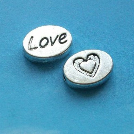 """10 """"Love"""" spacer beads, oval, silver tone, 11mm"""
