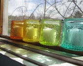 Set of 4 colored fluer de lis jars - orange, yellow, green and turquoise