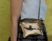 S A L E:   bronze gold leather shoulder sling