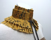 Pleated mustard yellow handprinted collar with leather ties