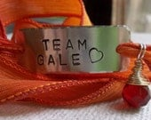 The Hunger Games Bracelet Wrap - TEAM GALE Hand Stamped with Fire Silk Ribbon Wrap