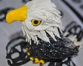 Cute Bald Eagle. Decorative bird figurine.