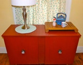 Vintage painted red credenza with metal feet