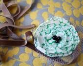 green polka dot poppy ribbon headband.