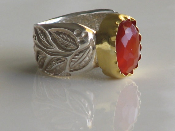 Cornelian Crown Ring, Outstanding cornelian stone enveloped with a 22 Karat Gold Bezel situated on a Sterling silver ring with petals design