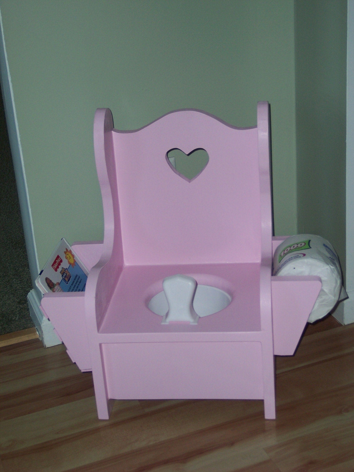 wooden potty chair with book rack and toilet paper. Black Bedroom Furniture Sets. Home Design Ideas