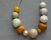 august necklace - vintage lucite and brass