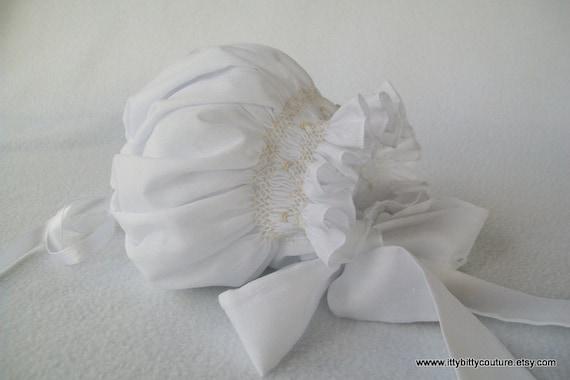 Smocked White Baby Bonnet with Ecru Smocking