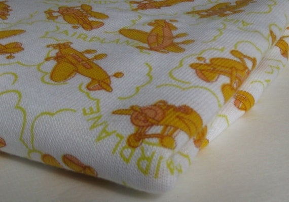 VINTAGE AIRPLANE FABRIC, white background with gold airplanes, knit fabric, measuring 42 inches by 1.5 yards
