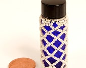 tiny pill beaded bottle
