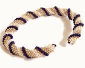 Tubular blue, silver, gold, pearl peyote bracelet