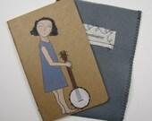 girl with her banjo-blank Moleskine Cahier journal