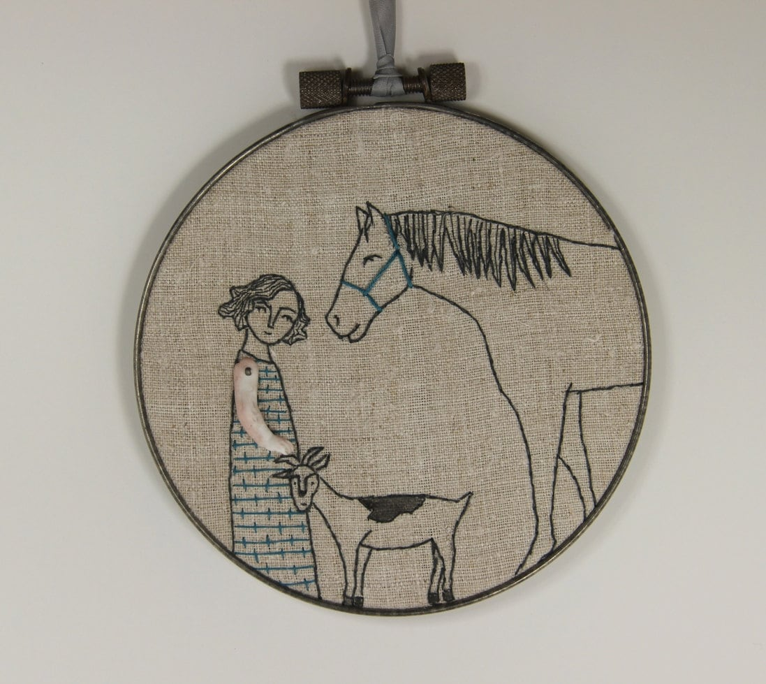 Hand embroidery girl with her horse and goat