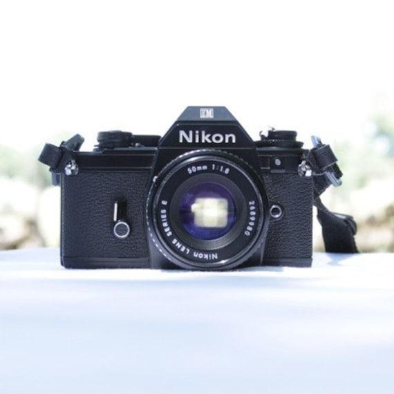 SALE Nikon Camera EM SLR 35 mm with Nikon Series E Lens 50mm 1.1.8  with Quantaray Q15 flash
