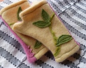 Vanilla and pink children's cashmere fingerless mittens made from recycled sweaters