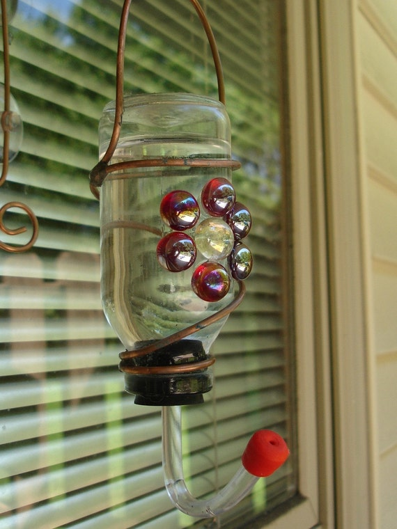 Hummingbird window feeder from recycled bottle and red stained glass