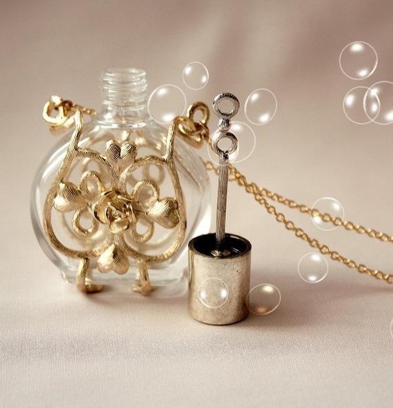 a love story . a vintage bubble blower perfume bottle necklace.