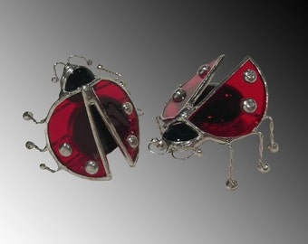 Bright red stained glass Ladybug, sits or stands.