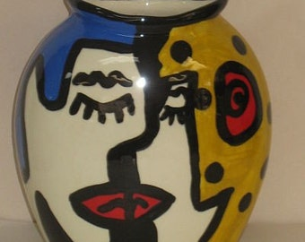 colorful ceramic vase with faces  kissing